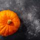 Orange pumpkin (Cucurbita pepo fruit) on dark textured backdrop w/ copy space,  top view - PhotoDune Item for Sale