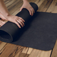 Close-up of young woman rolling her fitness mat - PhotoDune Item for Sale