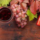 Red wine and grapes on wooden table - PhotoDune Item for Sale