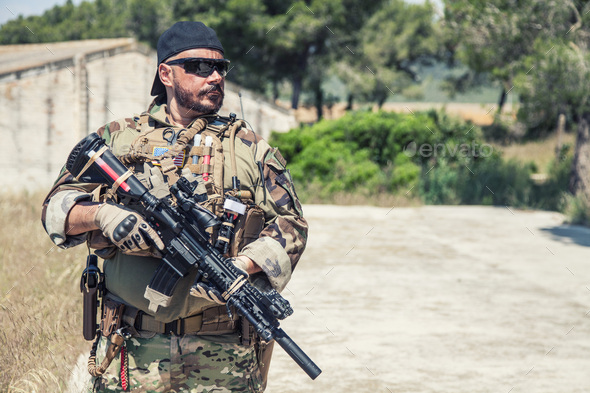 Portrait of equipped, armed US Navy SEALs fighter - Stock Photo - Images