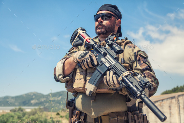 Private military company mercenary with gun - Stock Photo - Images