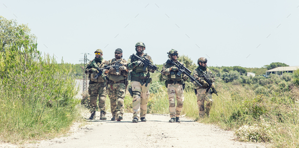 Army soldiers running on road in abandoned area - Stock Photo - Images