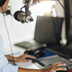 Podcast Concept - Female Host in Podcasting Studio - PhotoDune Item for Sale
