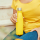 Young woman holding yellow reusable bottle - PhotoDune Item for Sale