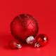Red Christmas baubles on a red background - PhotoDune Item for Sale