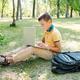 Modern boy typing on laptop - PhotoDune Item for Sale