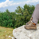 Legs of somebody taking rest on a stone during hiking in mountains - PhotoDune Item for Sale