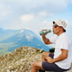 Men drinking from a reusable bottle during hiking in mountains - PhotoDune Item for Sale