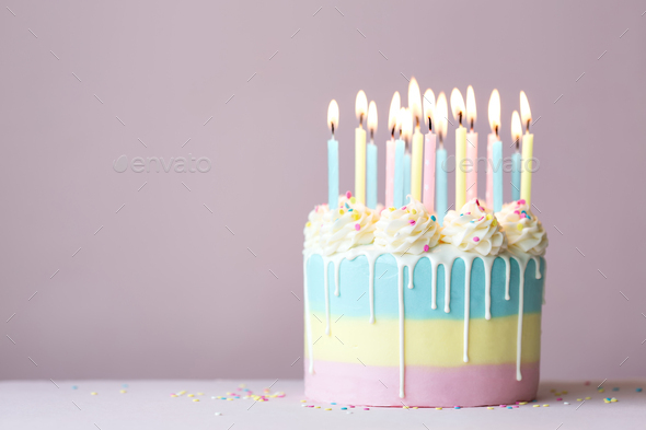 Pastel birthday cake with birthday candles - Stock Photo - Images