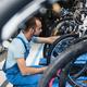 Bicycle shop, repairman looking on new bike - PhotoDune Item for Sale