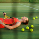 Tired female tennis player lies on court - PhotoDune Item for Sale