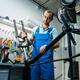 Bicycle assembly in workshop, man installs fork - PhotoDune Item for Sale