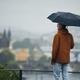 Man with umbrella during rain in city - PhotoDune Item for Sale