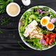 Greek style healthy breakfast bowl with oatmeal porridge and fresh vegetable salad - PhotoDune Item for Sale