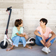 Mother and daughter sitting on an electric scooter - PhotoDune Item for Sale