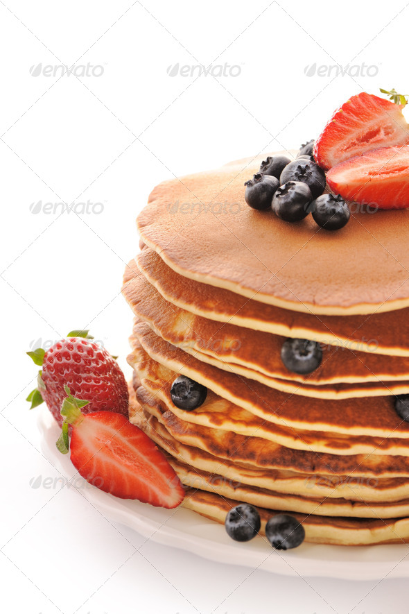 Pancakes with strawberry and blueberries - Stock Photo - Images