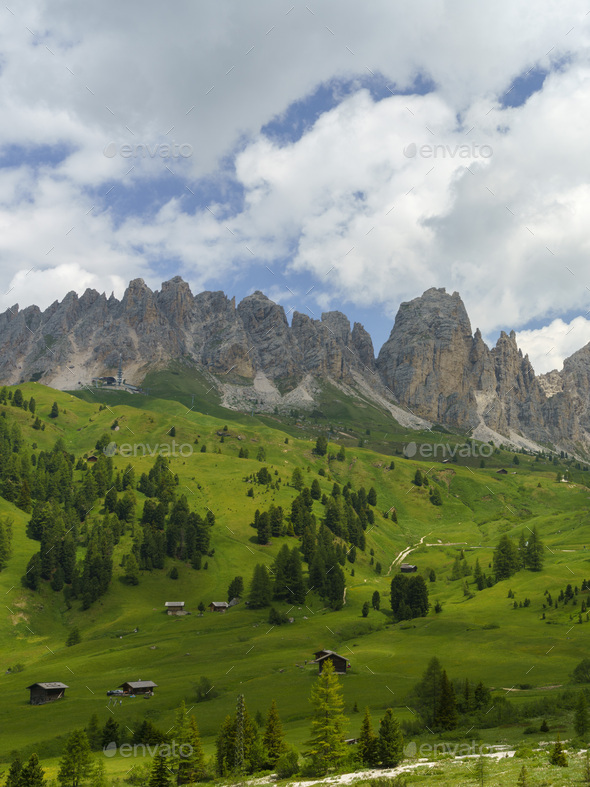 Mountain landscape along the road to Gardena pass, Dolomites - Stock Photo - Images
