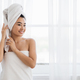 Asian woman wrapped in towel standing next to window - PhotoDune Item for Sale