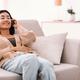 Asian woman listening to music wearing wireless headphones - PhotoDune Item for Sale