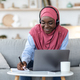 Online Education. Black Muslim Lady Studying With Laptop And Headset At Home - PhotoDune Item for Sale