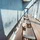 Sunny terrace design: cafe furniture with chair, desk at window with urban view. Soft beige interior - PhotoDune Item for Sale