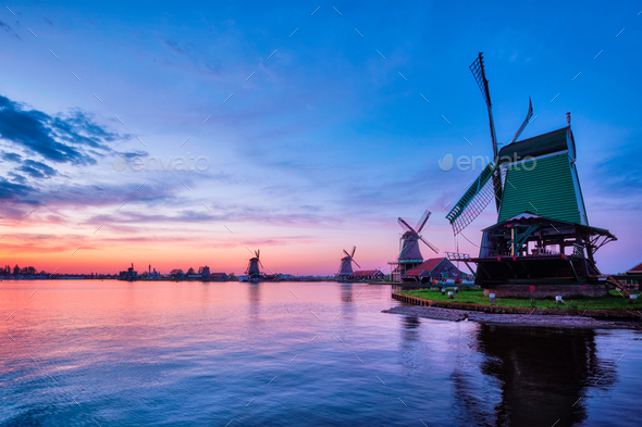 Windmills at famous tourist site Zaanse Schans in Holland with dramatic sky. Zaandam, Netherlands - Stock Photo - Images