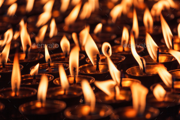 Burning candles in Buddhist temple - Stock Photo - Images