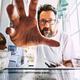 Adult caucasian man take healthy food from fridge - PhotoDune Item for Sale