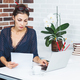 Business woman in the office an the desk verifying documents. - PhotoDune Item for Sale