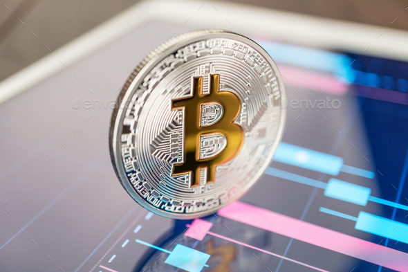 Bitcoin Cryptocurrency On The Tablet - Stock Photo - Images