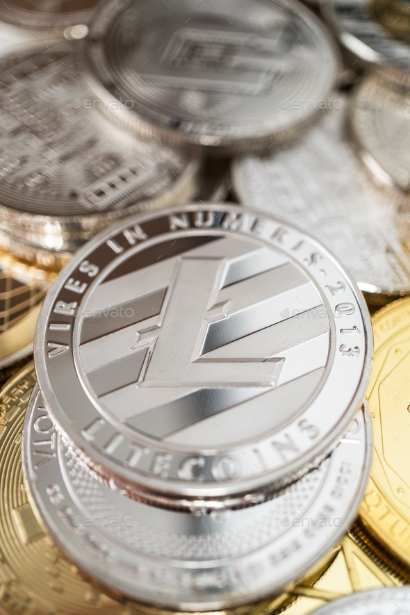 Close-up Of Litecoin Physical Coin On Stack Of Many Other Cryptocurrencies - Stock Photo - Images