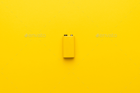 Blank Nine-volt Battery On The Yellow Background - Stock Photo - Images