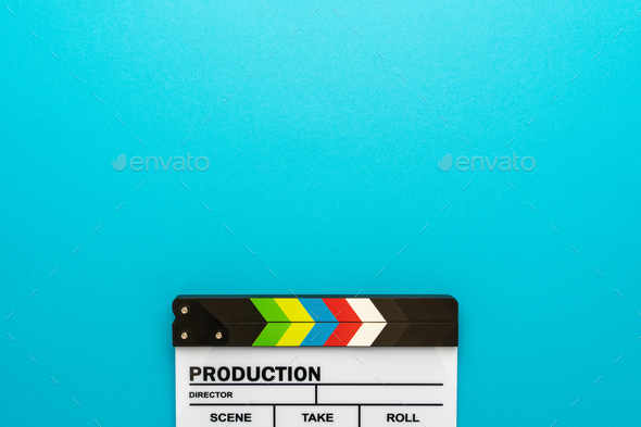 Top View Of Clapperboard At Bottom Of Turquoise Blue Background With Copy Space - Stock Photo - Images