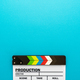 Top View Of Clapperboard At Bottom Of Turquoise Blue Background With Copy Space - PhotoDune Item for Sale