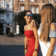 Young female friends enjoying walk along street - PhotoDune Item for Sale