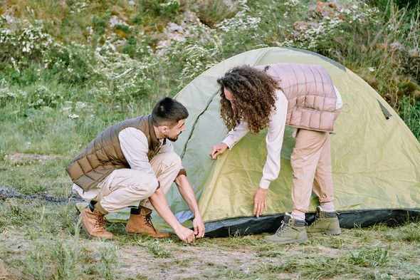 Couple setting up tent - Stock Photo - Images