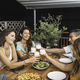 Friends Cheering With Beer Glasses Sitting Around a Table With Pizzas and Salads. - PhotoDune Item for Sale