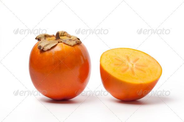 Whole and half Khaki fruit - Stock Photo - Images