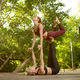 Girlfriends doing balance exercise, group yoga - PhotoDune Item for Sale
