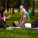 Cheerful parents and little baby play in park - PhotoDune Item for Sale