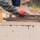 Construction Worker Leveling Wet Cement Into Wood Framing - PhotoDune Item for Sale