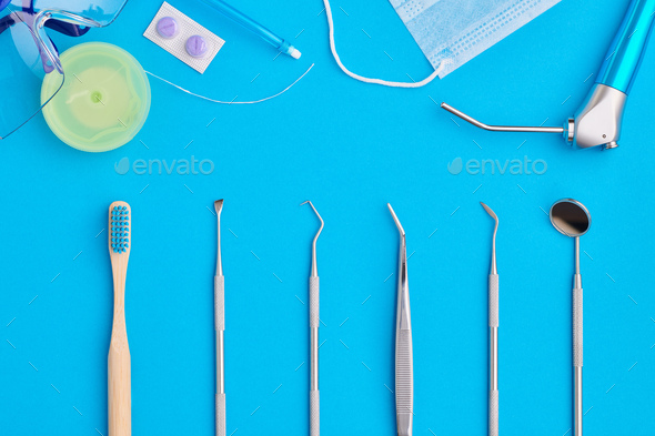 Dentist tools over blue background top view - Stock Photo - Images