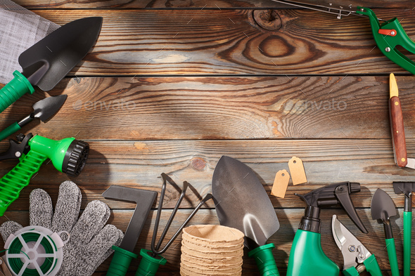 Gardening tools on wooden background flat lay - Stock Photo - Images