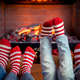 Feet in Christmas socks near fireplace - PhotoDune Item for Sale