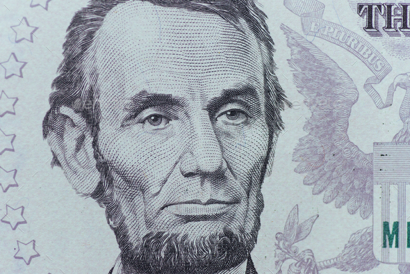 US President Abraham Lincoln face on five dollar bill macro, 5 u - Stock Photo - Images
