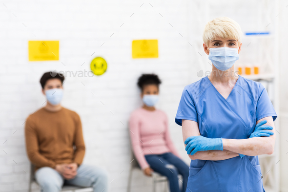 Lady Doctor Standing In Front Of Coronavirus Patients In Hospital - Stock Photo - Images