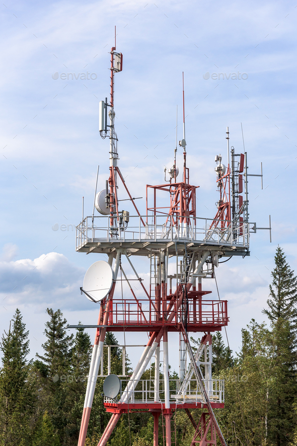 Communication tower with TV and cellular antennas - Stock Photo - Images