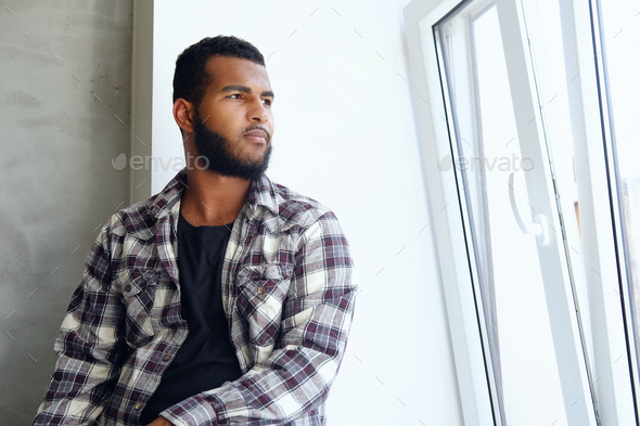 Portrait of Arabic hipster male in a fleece shirt. - Stock Photo - Images