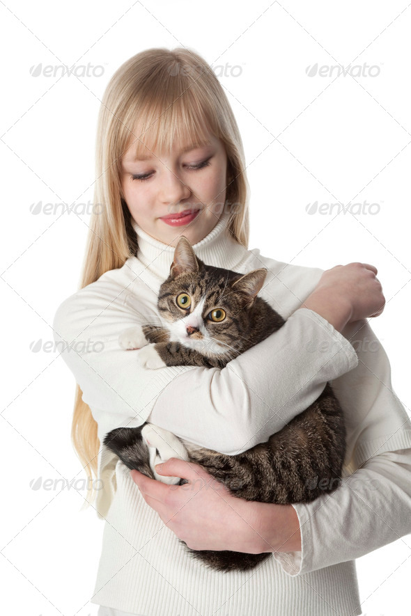 Portrait of a teenage gir with her pet cat - Stock Photo - Images