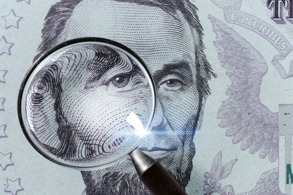 5 USD, US money close up under magnifying glass - Stock Photo - Images